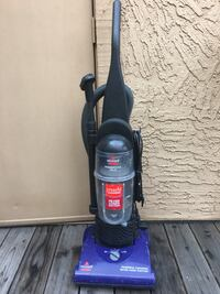 Purple and black bissell power force helix upright vacuum cleaner 2400 mi