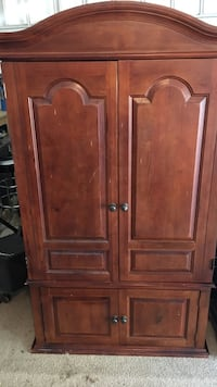 Armoire 6' high with pedestals One piece