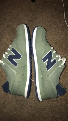 green New Balance athletic shoes