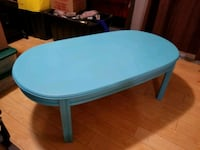 round blue wooden table with black metal base London