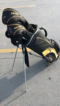 Black and yellow ultra golf bag with golf clubs Wichita, 67216