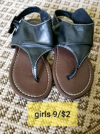 pair of black leather sandals Thorntown, 46071