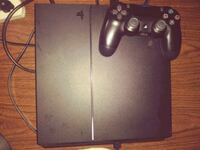 black Sony PS4 console with controller Washington, 20032