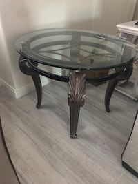 round glass-top table with black wooden base Bakersfield, 93307