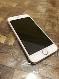 gold iPhone 6 with brown case Richmond Hill, L4E 5A8