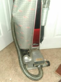 gray and red vacuum cleaner