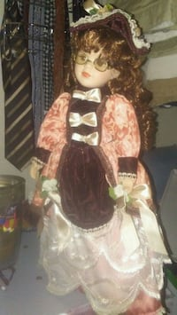 porcelain doll in brown and white dress Semmes, 36575