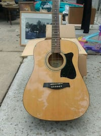 brown and black acoustic guitar Germantown, 20874