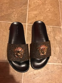 Versace slippers size 9 negotiable  Monticello, 12701