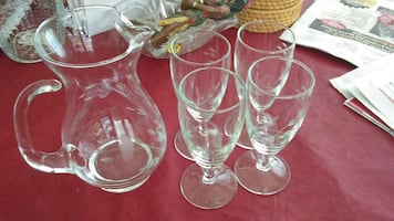 Glass pitcher and four stemmed glasses