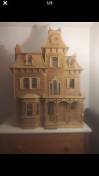 Wooden doll house.