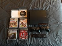 Black sony ps3 slim console with controller and game cases Hudson, 28638