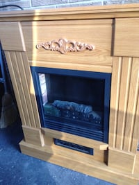 brown wooden framed electric fireplace Hamilton, L8T 4K7