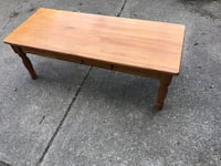 rectangular brown wooden 1-drawer coffee table