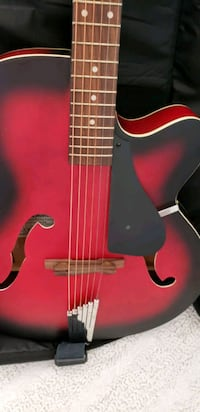 red and black acoustic guitar Mississauga, L4W