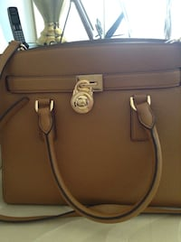 New Michael Kors leather handbag with shoulder strap. Never used. Calgary, T3K 3M4