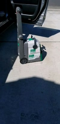 Commercial carpet cleaner used once comes all the bells and whistles