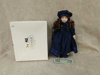 "Adorable Porcelain doll measuring 16"" Rockville"