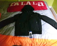 """Men's winter jacket(Tommy Hilfiger) size """"L"""" with hoody. Coquitlam, V3C 4B1"""