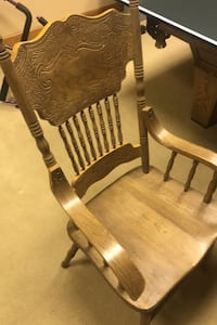 Pressed back oak armchairs