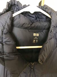 black and white The North Face zip-up jacket Arlington