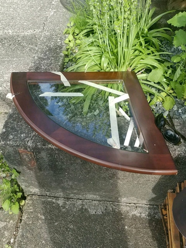 brown wooden framed glass top table 0491f5fe-c0c8-4e8b-93a7-0a905bb0184e