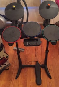 Wii Drum set, Guitar and game holder.