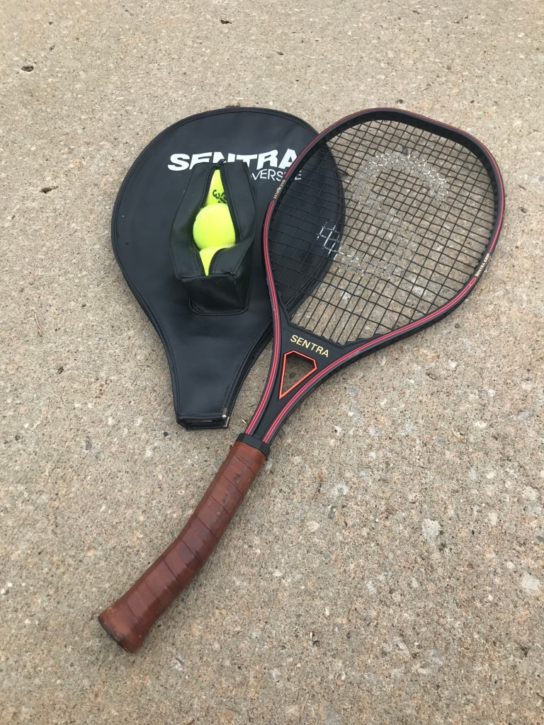 Photo Used tennis racquets with covers