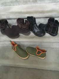 two pairs of black and brown leather boots Burlington
