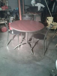 round brown wooden table with four chairs dining set Hagerstown