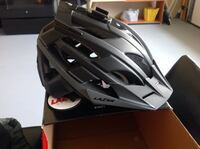 Black and white bike helmet  lazer holds a GoPro and come with a duffle bag top tier helmet  Woodbridge, 22193