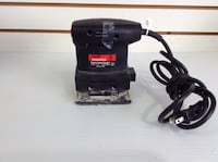 black and gray corded power tool