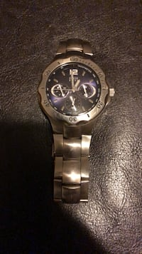 Round silver-colored chronograph watch with link bracelet. Needs battery.   London, N6M 1L9