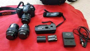 Pentax K20D DSLR camera with 3 Lenses and hand Grip.