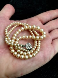 Graduated necklace of cultured faux pearls and detailed silver secure clasp