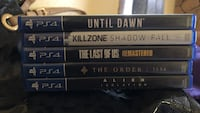 four Sony PS4 game cases
