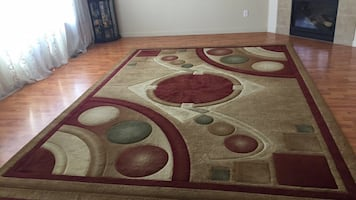 White, brown, and red area rug
