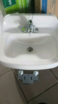 ceramic white sink with faucets bairly used ,I hav Commerce Charter Township, 48390
