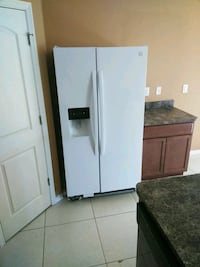 white side-by-side refrigerator with dispenser 893 mi