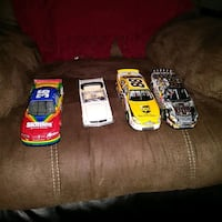 four several color assorted die-cast car toys