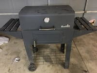 Charbroil brand charcoal grill. Comes with rotisserie attached 1071 mi