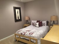 brown wooden bed frame with white and black comforter set Ashburn, 20148