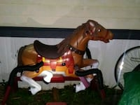 brown and black rocking horse Mason