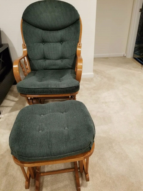 brown wooden framed green padded glider chair