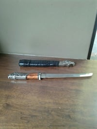 stainless steel and brown hilt sword with sheath