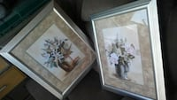 2 silver picture frames with corporate art