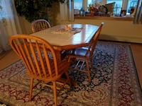 rectangular brown wooden table with six chairs din