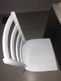 A SET OF TWO WHITE DINING CHAIRS Boston, 02110