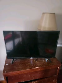 black flat screen TV and brown wooden TV stand Centreville, 20120
