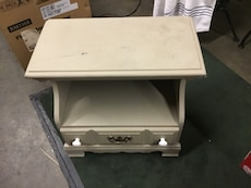 beige wooden side table with drawers